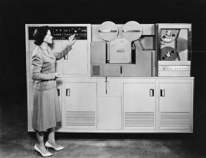 Woman standing next to tape drives